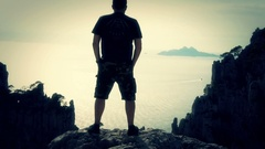 Young male tourist enjoying beautiful view in the mountains HD Stock Footage