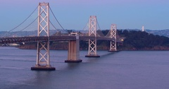 Aerial of San Francisco Bay Bridge at sunrise Stock Footage