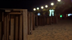 Variable focus on the beach at night. Many loungers lie on the sand. Stock Footage