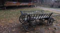 Wagon horseOld wooden cart near the old traditional european wooden village Stock Footage