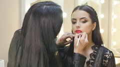 The makeup artist does makeup for the bride Stock Footage