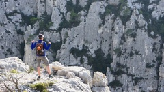 Successful woman raising hands in the mountains, Calanques, France HD Stock Footage