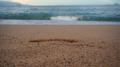 The imprint of his feet in the sand. Stock Footage