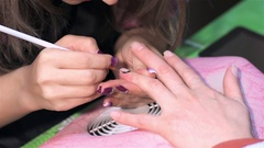Staining nails with black lacquer. Close up Stock Footage