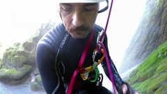Climber man rappel from a high waterfall Stock Footage