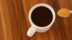 Male hand stirring a cup of coffee Stock Footage