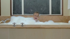 Playful child having bath with foam Stock Footage