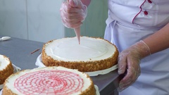 Confectioners hands decorating cakes. Cake production process Stock Footage