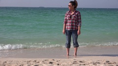 Portrait of businesswoman in vacation in the beach sand calm ocean background 4K Stock Footage