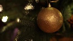 Golden glitter christmas tree balls on christmas tree and shining lights Stock Footage