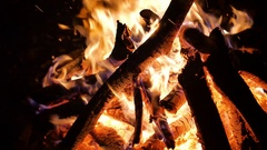 Flames of fire place lit the bonfire night sparks smoldering logs and falling Stock Footage