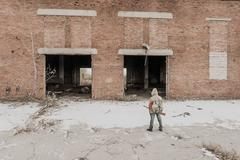 Young boy stands near the abandoned building Stock Photos