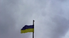 Flag of Ukraine, pierced by bullets Stock Footage
