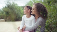4K Happy mother & daughter at the zoo looking into animal enclosure Stock Footage