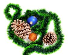 Green Christmas tinsel, Christmas-tree balls and big pine cones Stock Photos