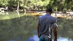 Cedar Creek Falls, Young Man scratching head Stock Footage