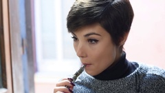 Young pretty woman smoking electronic cigarette Stock Footage