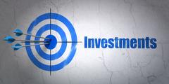 Currency concept: target and Investments on wall background Piirros