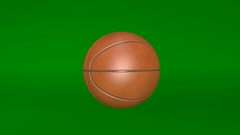 Basketball, spinning ball, sports equipment isolated on green background Arkistovideo
