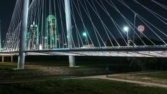 Dallas night skyline panning timeLapse with moon Arkistovideo