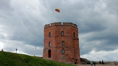 Lithuanian national flag n Gedemin tower in Vilnius Stock Footage