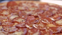 Pizza with salami close-up Stock Footage