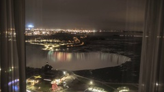 TIme Lapse of Niagara Falls at Night From Hotel Room Window Stock Footage