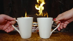 Hands putting mug fireplace warming winter holiday relaxing Stock Footage