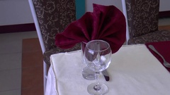 Glass and table napkin preparation for the adoption of its visitors Stock Footage