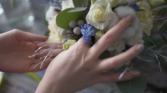 Florist girl hands closeup making a flower composition Stock Footage