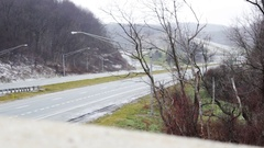 Highway traffic on snowy day shot from overpass perspective Version  Stock Footage