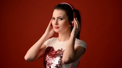 Beautiful girl listening to music Stock Footage