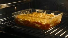 Making lasagne in the oven Stock Footage