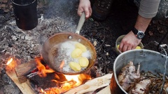 Potatoes fried in a pan in outdoor Stock Footage