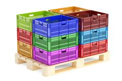 Stack colored plastic crates on the wooden pallet, 3D rendering Stock Illustration