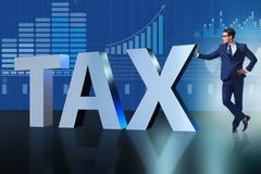 Businessman in high taxes concept Stock Photos