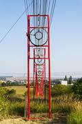 Communication wires lead to switching station from radio transmitter tower Stock Photos