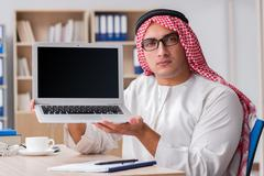 Arab businessman working in the office Stock Photos