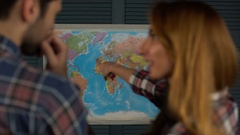 Young tourist couple looking at world map will travel Stock Footage