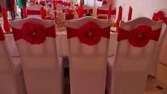 Chairs in a restaurant decorated with ribbons flashes lumiere holiday Stock Footage