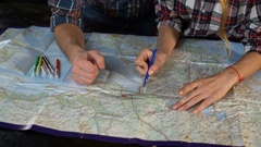 Young tourist couple draws the route on the map Stock Footage