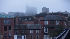 Windsor in a deep fog: Castle and the town in England Stock Footage