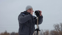 Man makes a picture with a tripod. Stock Footage