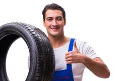 Handsome tyre repairman isolated on white Stock Photos