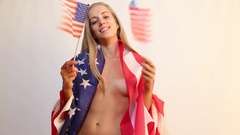 Naked girl with American flag Stock Footage