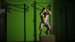 Muscular man doing a box jump. gym. CrossFit Stock Footage