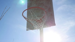 Old basketball hoop sport street against a blue Stock Footage