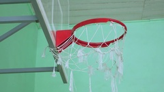 Basketball hoop and a billboard sport in the school gym Stock Footage