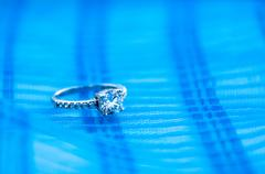 Silver ring with cubic zirconia on a blue background Stock Photos