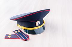 Cap and epaulets of lieutenant colonel are on the table Stock Photos
